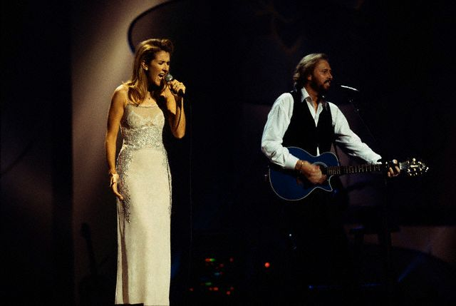 Céline Dion joins Barry Gibb of the Bee Gees on stage during the group's 1997 One Night Only concert at the MGM Grand in Las Vegas. (© Neal Preston/CORBIS)