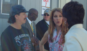 Carlos Santana and Céline Dion talk with ABC's Cheryl Miller at Super Bowl XXXVII (© A. Fells)