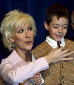 Céline Dion adjusts the tie of six-year-old Gaston Etienne Bellei-Rodriguez. (© AP PHOTO/CP, Ryan Remiorz)