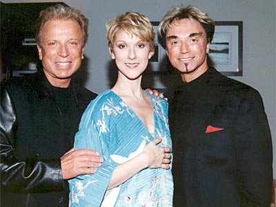 Siegfried & Roy and Céline Dion backstage at the aftershow of the VIP-Premiere of Céline Dion's show at Las Vegas's Caesars Palace hotel. (© Peter Bischoff)