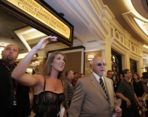 Céline Dion tours the lobby of the new Augustus Tower at Caesars Palace in Las Vegas, with her husband Rene Angelil. (© AP Photo/Joe Cavaretta)