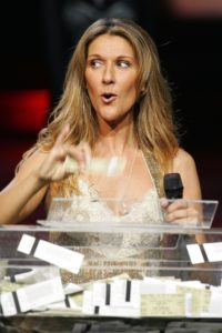 Céline Dion gives away prizes to members of the audience at the end of the 500th performance of A New Day..., in Las Vegas. (© Ethan Miller/Getty Images Entertainment)