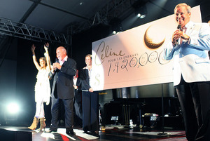 Céline Dion, Rene Angelil and Jacques Menard unveiling the check (© Richard Gauthier /CNW)