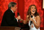 Entertainer Jerry Lewis (L) jokes with singer Céline Dion. (© Ethan Miller/Getty Images)