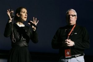 Louis J. Horvitz, director of the 79th Academy Awards, watches singer Céline Dion during rehearsals. (© AP Photo/Chris Carlson)