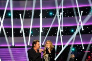 "Céline Dion and Johnny Hallyday performing ""L'amour peut prendre froid"" (© Photo Collaboration spéciale, Marc CHAUMEIL)"