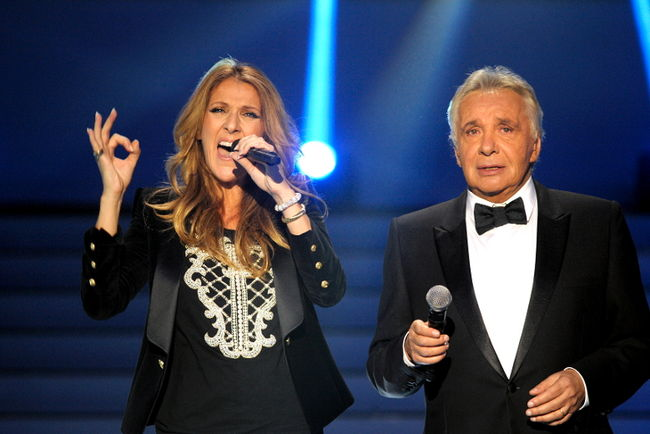 "Céline Dion and Michel Sardou performing ""Voler"" (© Photo Collaboration spéciale, Marc CHAUMEIL)"