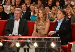 """Céline Dion appears on the French television show """"Vivement Dimanche"""" with Alain Delon and Serge Lama. (© Eliot Press/Bauer Griffin)"""
