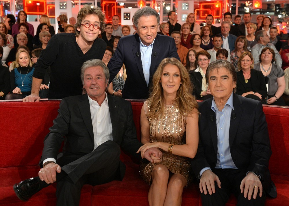 "Céline Dion appears on the French television show ""Vivement Dimanche"" with Alain Delon, Fred Pellerin, Michel Drucker and Serge Lama. (© Eliot Press/Bauer Griffin)"