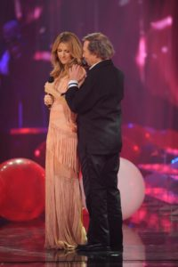 "Celine singing ""Une chance qu'on s'a"" with Jean-Pierre Ferland on the set of 'Céline Dion… Sans attendre' (© OSA Images)"